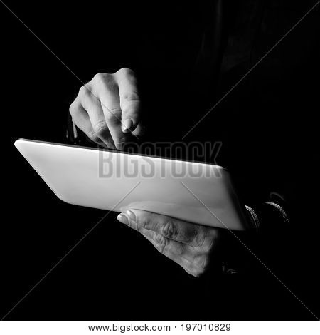 Female Hands Isolated On Black Background Using Tablet Pc