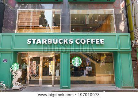 SEOUL, SOUTH KOREA -  CIRCA MAY, 2017: Starbucks coffee shop in Seoul. Starbucks Corporation is an American coffee company and coffeehouse chain.