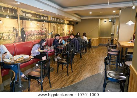 SEOUL, SOUTH KOREA -  CIRCA MAY, 2017: people at Starbucks coffee shop in Seoul. Starbucks Corporation is an American coffee company and coffeehouse chain.