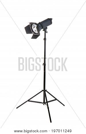 Studio flash isolated on a white background. Photo-studio with lighting equipment. Modern powerful photographic flash. Professional equipment. Studio photography video light. A long tripod.