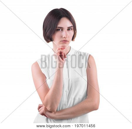 A beautiful and thoughtful young woman posing isolated over the white background. An attractive business lady standing in a thinking pose. A curious and professional female in casual clothing.