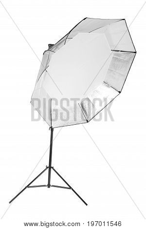 A professional studio octobox isolated over the white background. A dark saturated black octobox on a long metal tripod. Photographic equipment for photographers. Photo business.