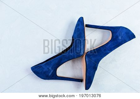 Blue High Heel Shoes On Light Blue Background. Female Shoes