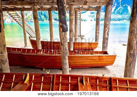 Wooden Boats Under Boat House On Braies Lake