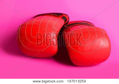 Idea Of Healthy Lifestyle With Red Boxing Gloves On Pink