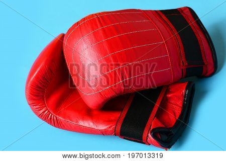 Pair Of Leather Boxing Sportswear. Sport Equipment On Cyan Blue