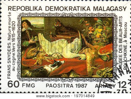 UKRAINE - CIRCA 2017: A postage stamp printed in Madagascar shows Frans Snyders: Still Life with Swan 1615-1620 from series Paintings from Pushkin-Museum Moscow circa 1987