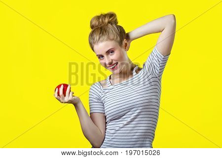 Woman In White Striped Top On Yellow Background .