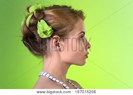 Attractive Blonde Woman On Green Background.