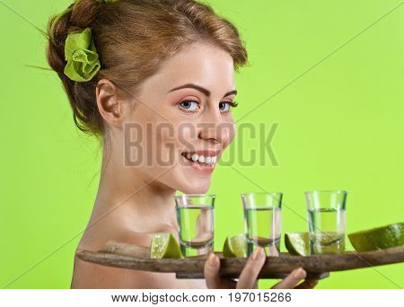 Beautiful Woman With Glasses Of Tequila .