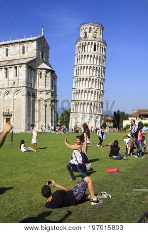 PISA - JULY 6: Tourists make funny pictures with famous leaning tower  in Pisa, Italy on July 6, 2011