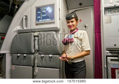 DOHA, QATAR - CIRCA MAY, 2017: Qatar Airways crew member on board of Airbus A321. Qatar Airways is the state-owned flag carrier of Qatar.