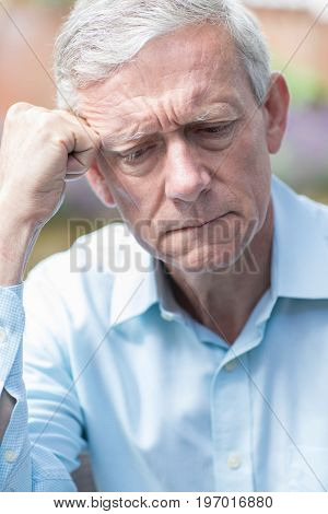 Head And Shoulders Shot Of Worried Senior Man