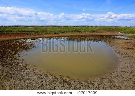 salt pond in steppe in sunny summer day