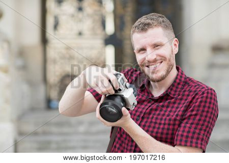 Portrait Of Male Photographer Working In Street