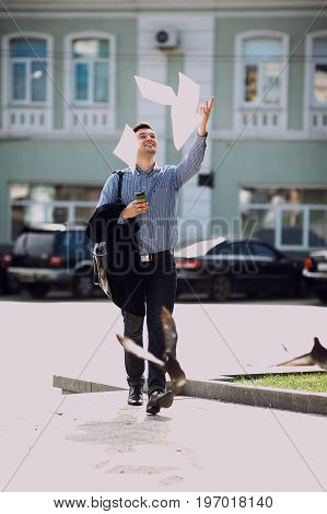 Confident and happy adult man took vacation. Joyful and free businessman on street