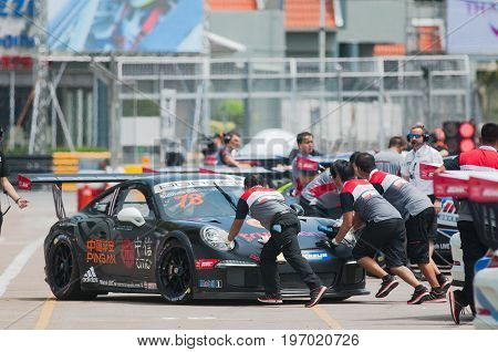 Bang Saen Thailand - July 1 2017: The Porsche GT3 Cup of Suttiluck Buncharoen from Thailand being pushed at the pit lane during Porsche Carrera Cup Asia at Bang Saen Street Circuit in Bang Saen Chonburi Thailand.