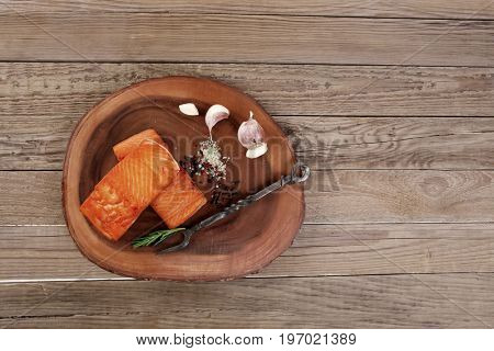 breakfast delicious portion of fresh roast salmon fillet with dry spices garlic and rosemary wooden plate black forged handmade fork healthy food diet cooking concept background empty space for text