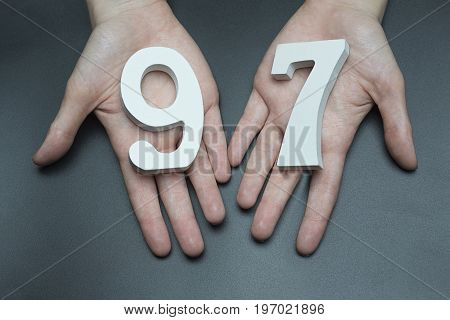 To Female Hands The Figure Of Ninety-seven.