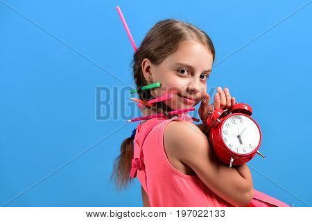 Kid In Pink Dress With Cute Braids And Colored Pencils