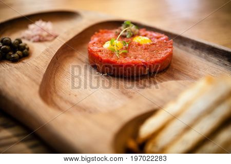Boeuf a la tartar. Made from hand-chopped internal beef fillet served with raw egg and croutons.