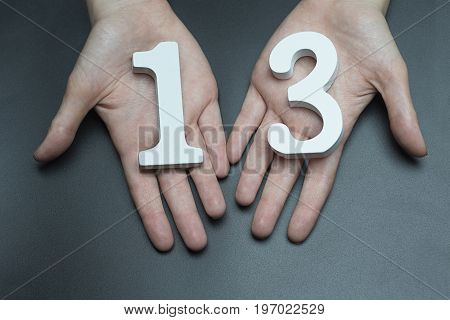 To Female Hands The Number Thirteen.