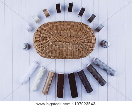 Background with stylish sewing tools and accessories on wooden table.