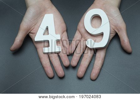 To Female Hands The Number Forty-nine.