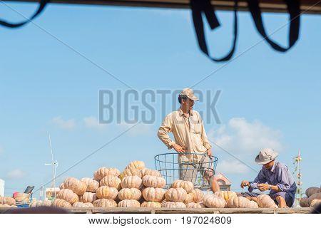 MEKONG DELTA, VIETNAM - April 25, 2014 - Vietnamese farmers sell pumpkins at Asian floating market on Mekong river in Vietnam
