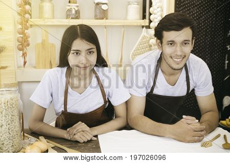 portrait of young couple lover in the kitchen