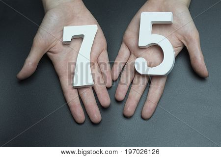 To Female Hands The Figure Of Seventy-five.