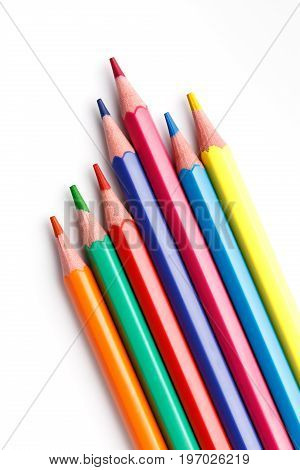 Color pencils isolated on white background. Many different colored pencils. Colored drawing pencils in a variety of colors