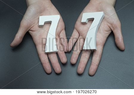 To Female Hands The Figure Of Seventy-seven.