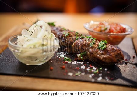 Lula kebab. Prepared from meat of black angus. Served with tomato salsa