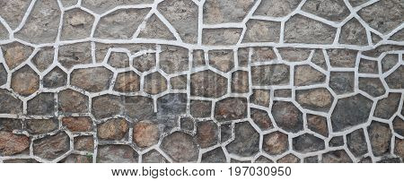 Surface of a wall made of rough stone blocks