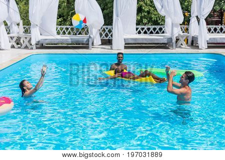 Group Of Young Happy Multiethnic People Having Fun Together In Swimming Pool