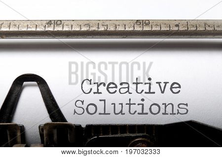 Creative solutions close up on a typewriter