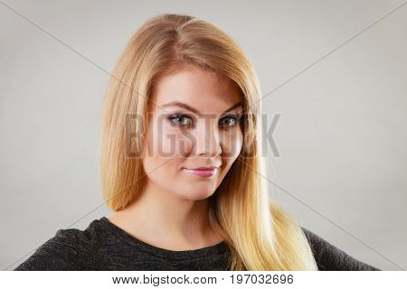 Portrait Of Happy Blonde Woman Smiling With Joy