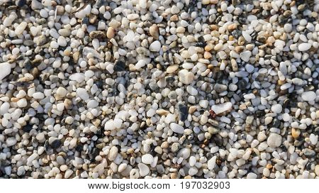 Sea beach close-up - small pebbles textured background