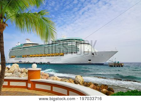 Luxury Cruise Ship in Port on sunny day .