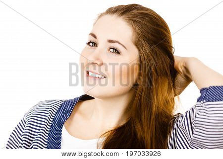 Feminine beauty concept. Portrait of beautiful young woman with long brown hair wearing dressing gown