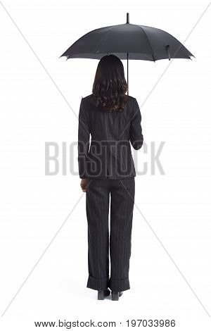 young asian businesswoman holding a black umbrella rear view studio shot isolated on white background.