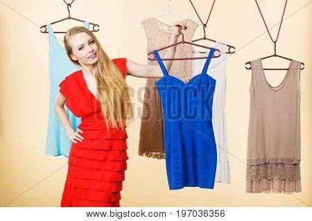 Woman In Shop Or Wardrobe Picking Dress