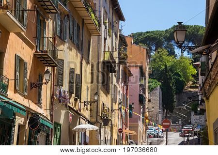 Narrow street in old part of Nice - fifth populous city and one of the most visited in France.