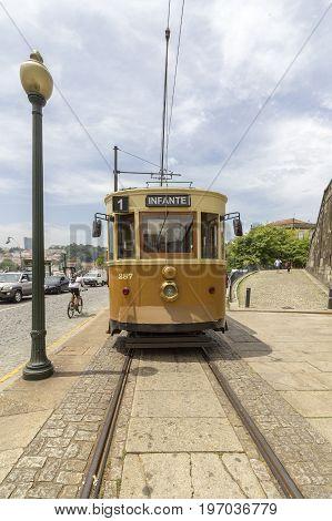 PORTO PORTUGAL - JUNE 25 2017: Famous Heritage yellow tram called Electrico in the center of Porto On June 25 2017 in Porto Portugal.