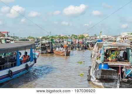 MEKONG DELTA, VIETNAM - April 25, 2014 - Asian floating market on Mekong river in Vietnam