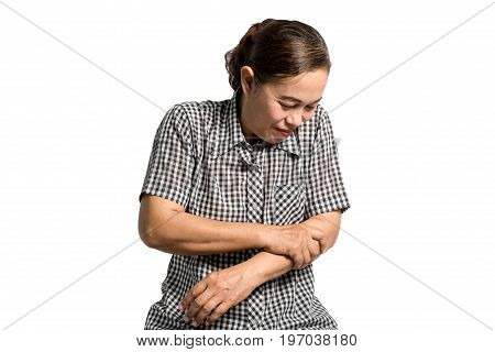 Portrait Of A Mature Woman Having An Arms Pain. Isolated On White Background With Clipping Path