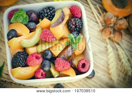 Fruit salad with fresh organic fruit in bowl - healthy eating healthy food