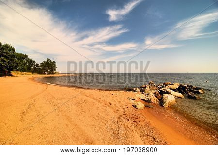 The red sandy beach of Sandy Point State Park near Annapolis, Maryland