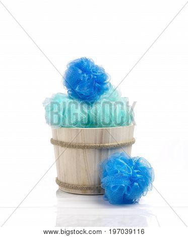 Blue color sponges into a wood basket against a brilliant bathroom ambience.